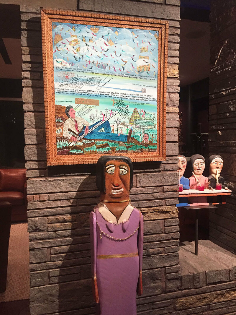 "Sculpture by William Dawson (""Aretha Franklin"") and painting by Howard Finster (""Vision of Brutonia"")"