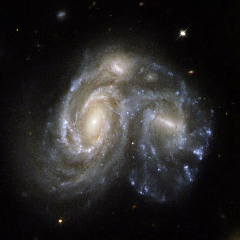 A Hubble telescope image of two spiral galaxies colliding.