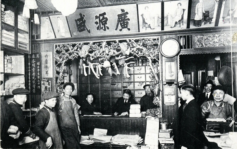 Lee B. Lok (center) at his store, Quong Yuen Shing & Co, on Mott Street, New York, c. 1917.