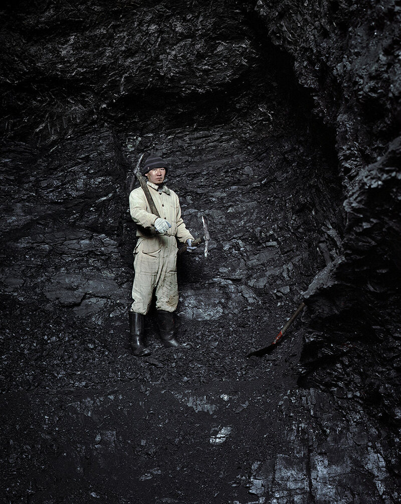 A coal miner in Min Kush. The city was known for its uranium, but there are also coal reserves. The workers walk three miles into the mountain each morning.
