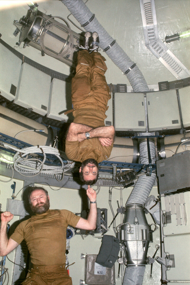 Carr holds up Pogue, with some zero-G help. Beards are again on full display.