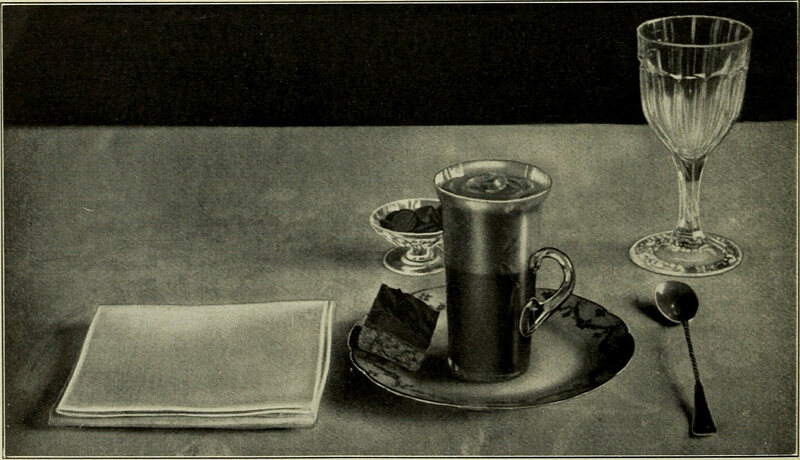 A place setting with a napkin from <em>American Cookery</em>, 1914.