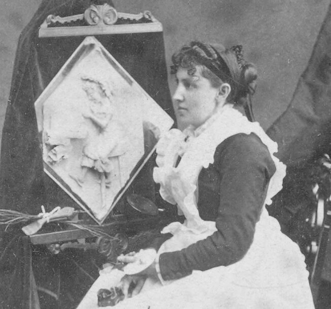 Caroline Brooks poses with one of her sculptures during her U.S. tour in 1877.