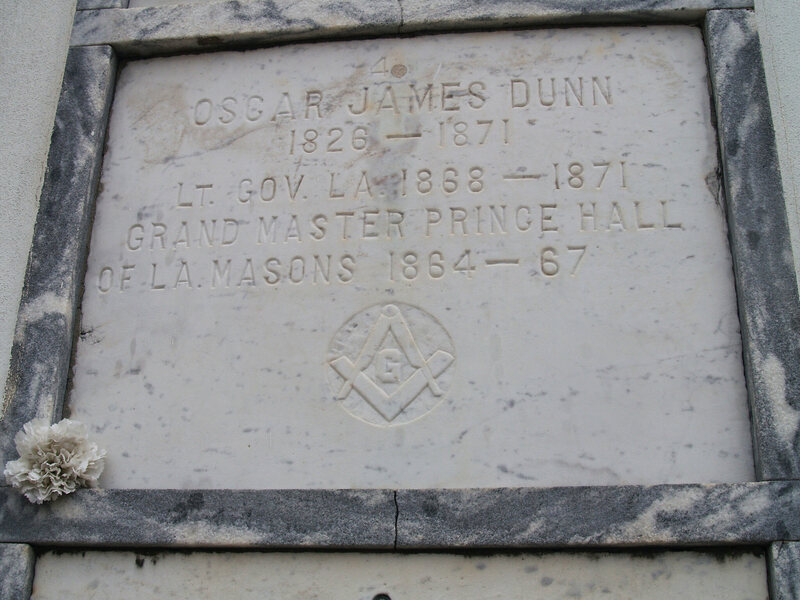 The plaque at Oscar Dunn's tomb in St. Louis Cemetery.