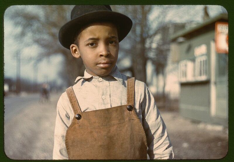 A boy wearing corduroy overalls, early 1940s.