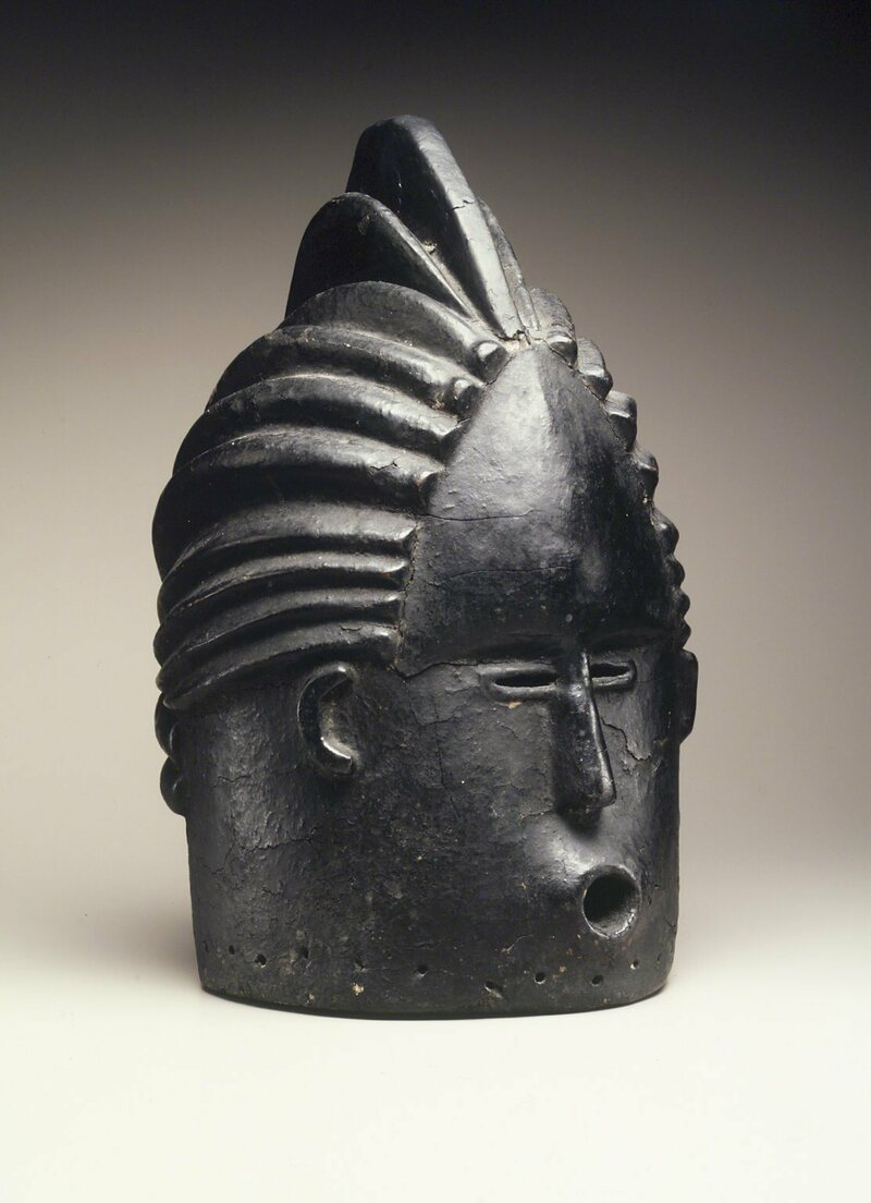 "This ""helmet mask,"" made of wood and tar, dates to the early 20th century and is currently in the collection of the Brooklyn Museum, in New York."