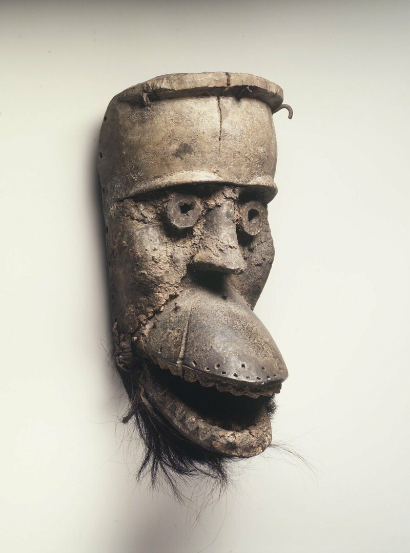 This 19th-century mask, with a hinged jaw, is thought to be a peacemaking one, with its nearly closed eyes and small mouth.