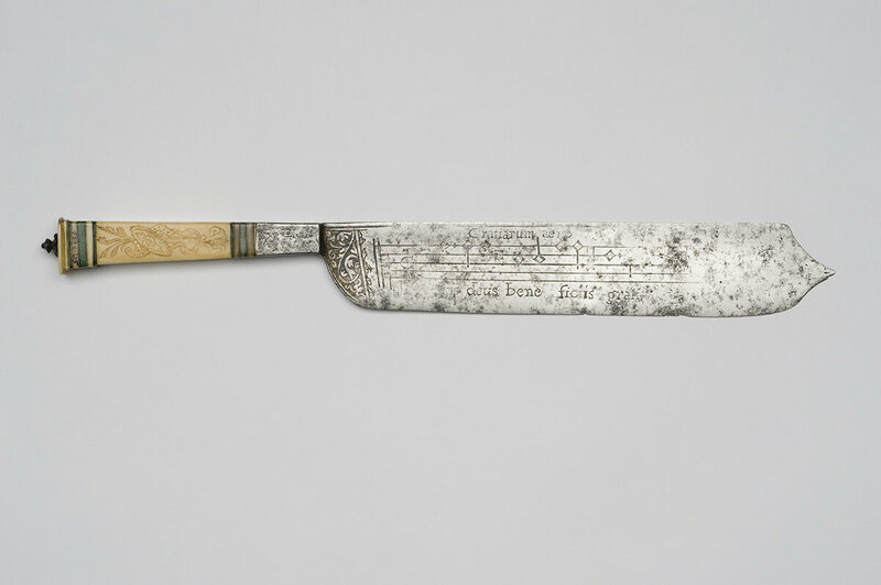 The knives are inscribed with musical notes and a prayer.
