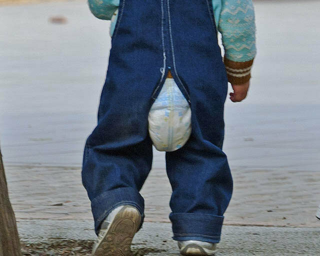 The best of both worlds? A toddler in both diapers and open-crotch pants.