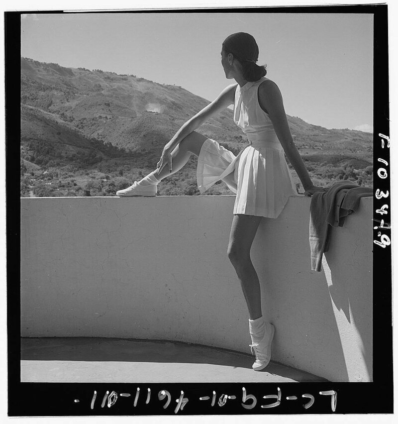 A woman in a tennis outfit, shot by Toni Frissell for <em>Harper's Bazaar, 1947.