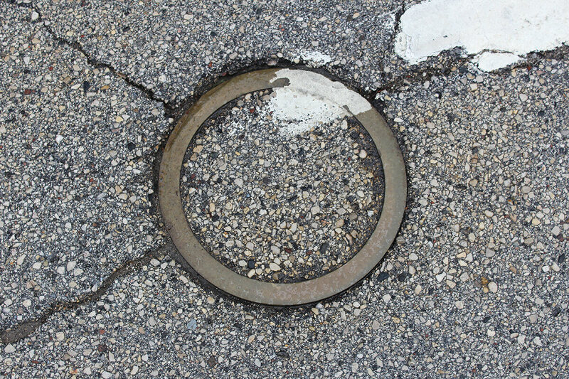 This ring at the intersection of Park and North 8th Streets in Manitowoc marks where Sputnik IV smashed into the street in 1962.