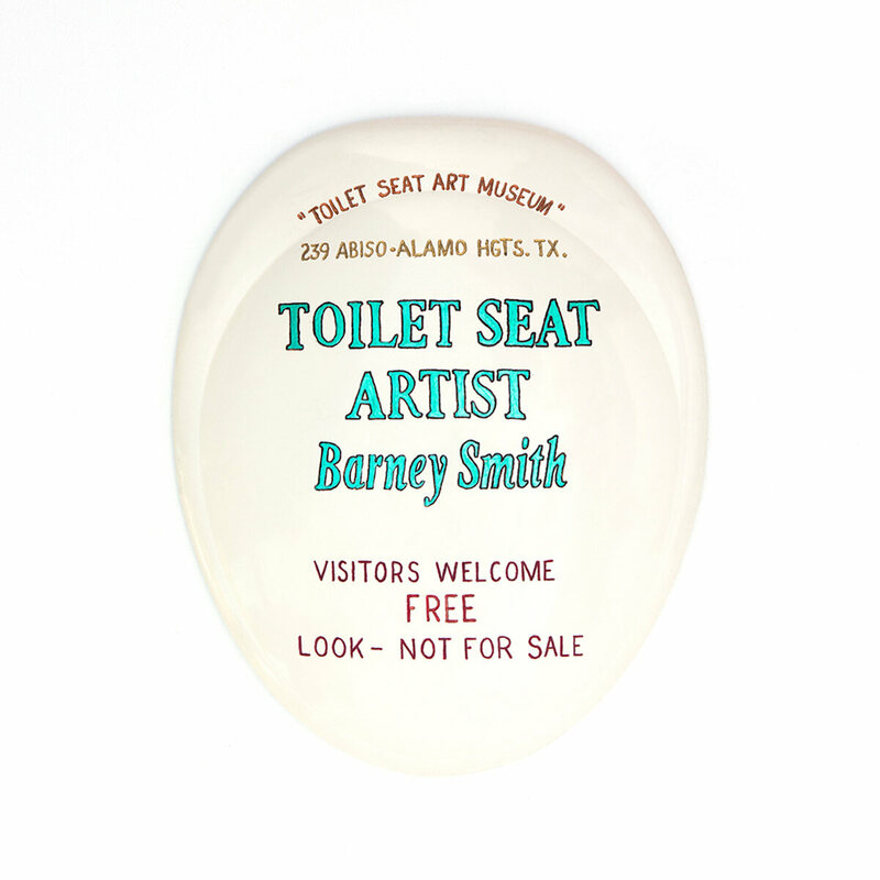 The sign for the museum is, appropriately, on a toilet seat.
