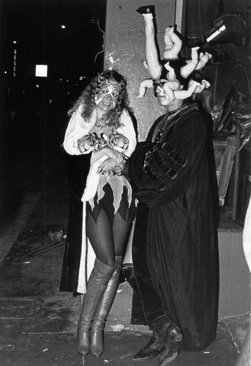 Two partiers in extravagant costume on Polk Street for Halloween 1980.