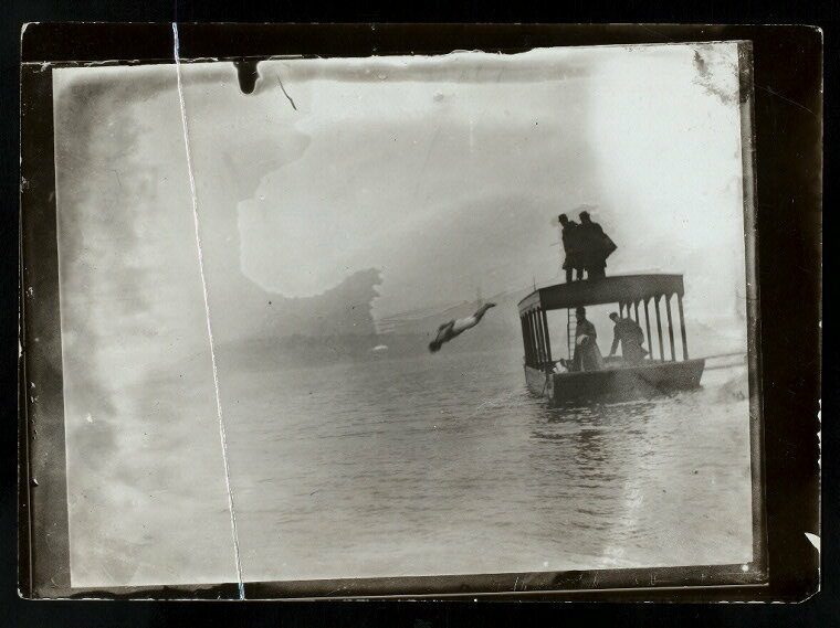 Harry Houdini diving handcuffed into the water