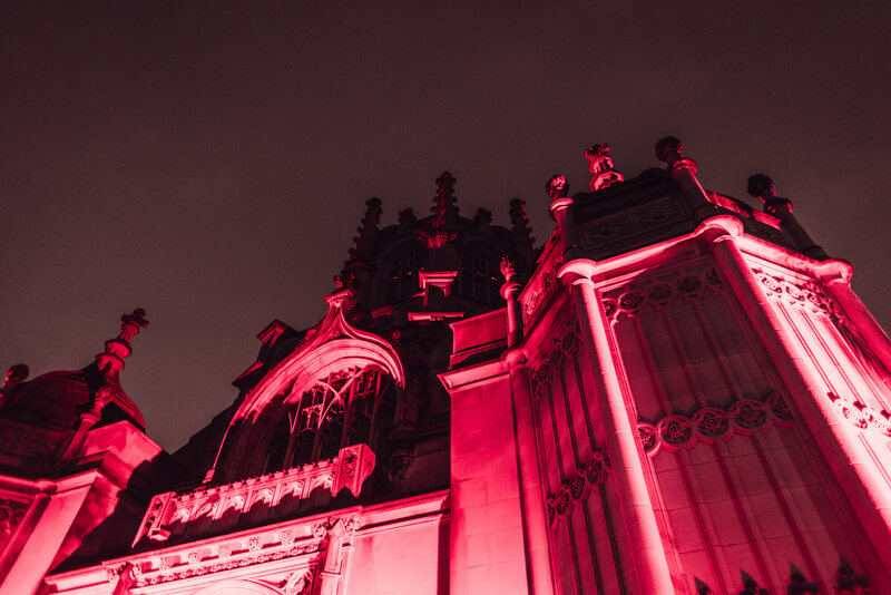 The Gothic arches of Green-Wood's chapel were underlit a deep crimson.