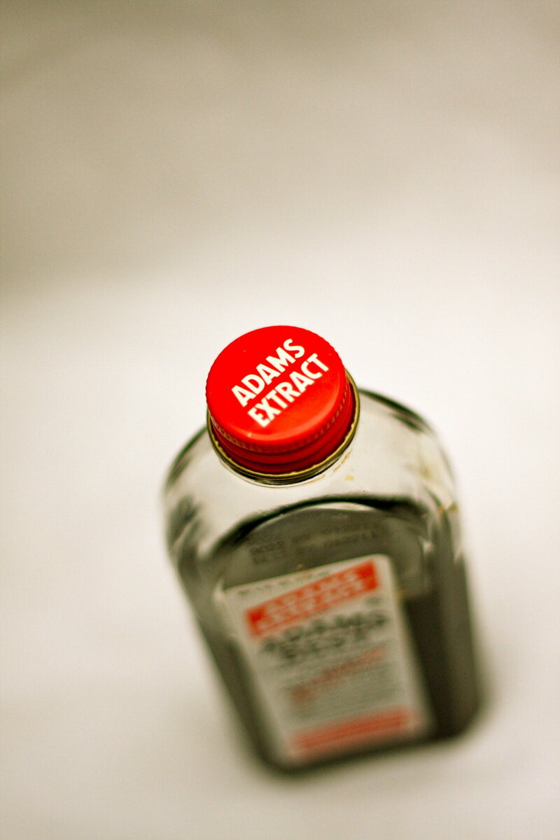 A bottle of Adams vanilla extract, shot from above.