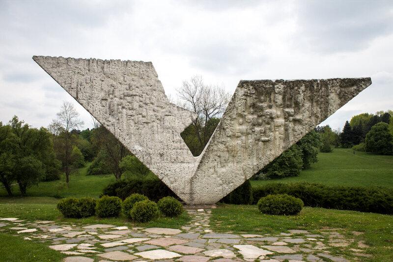 """Interrupted Flight"" monument at Šumarice Memorial Park in Serbia."
