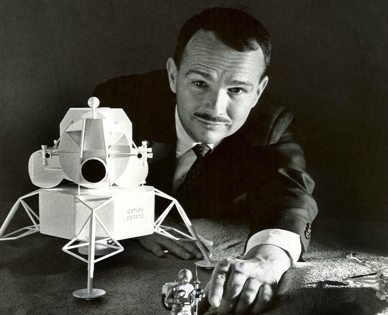 Eugene Shoemaker looking over a moon model of his own making.