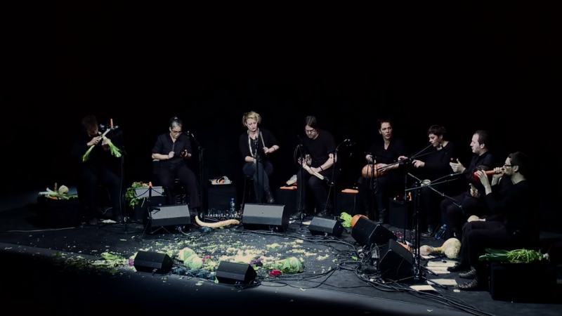 The Vegetable Orchestra performing at TEDx, with the remains of shredded cabbage at their feet.