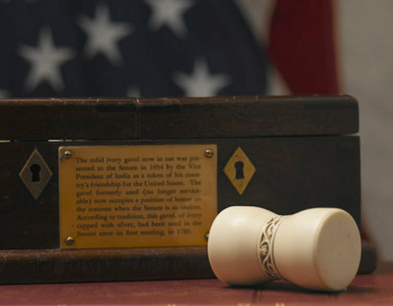 The new Senate gavel next to its box.