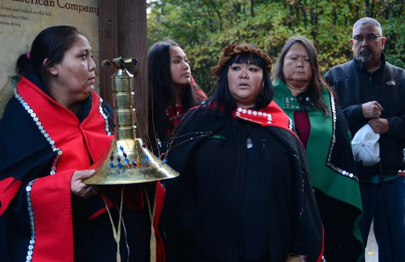 On October 15, Dionne Brady-Howard (center) and her mother Louise Brady (in green) gather with other members of the Tlingit tribe at the base of Noow Tlein, a former Kiks.ádi clan settlement.