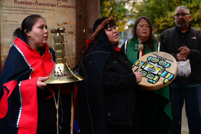 Dionne Brady-Howard, of the Kiks.ádi clan, leads a mourning song in a commemoration ceremony on October 15.