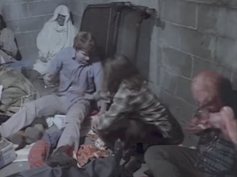 An Odd Fellows skeleton (top left) shows up in Dawn of the Dead, wrapped in a sheet and surrounded by zombies.