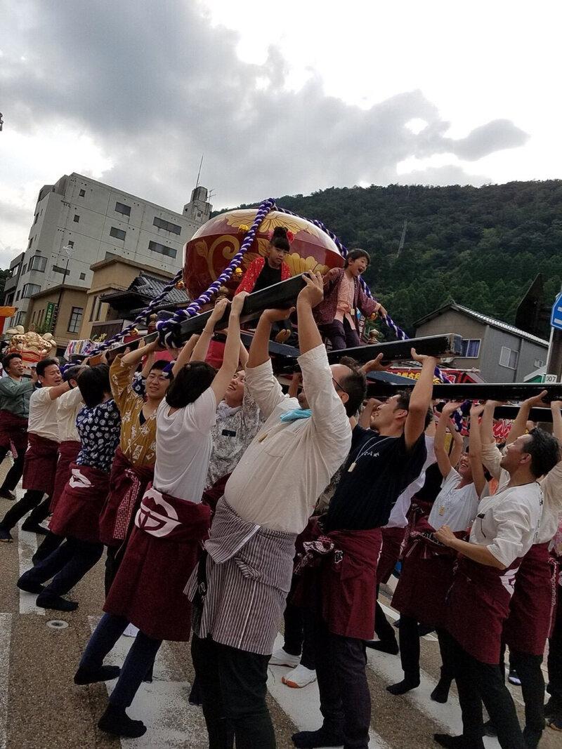 "The team shouts ""Sa— Sa— Sa—!"" as they practically toss the owan-mikoshi into the air."