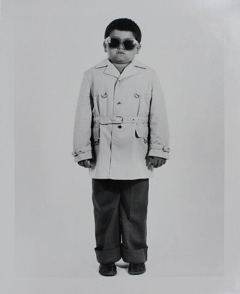 <em>Boy with Trench Coat and Sunglasses</em>.