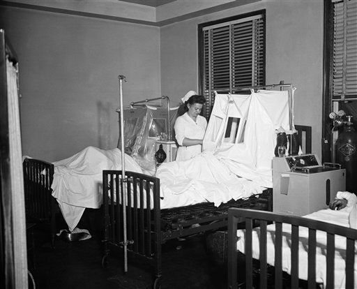 A smog victim recovers in an oxygen tent at Charleroi-Monessen Hospital.