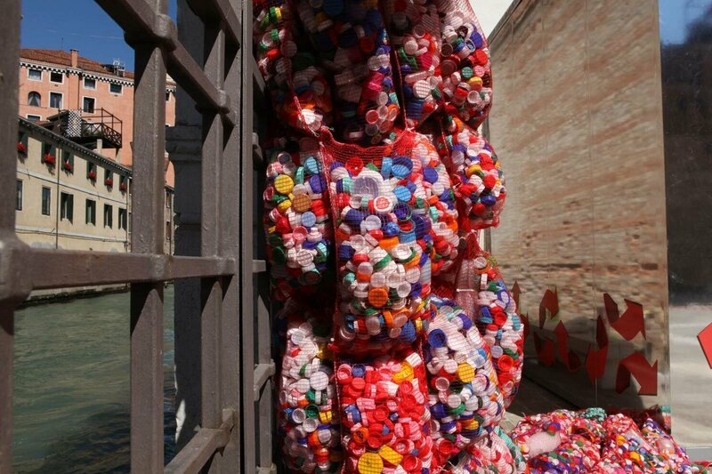 Sacks of plastic bottlecaps in one of Finucci's installations.