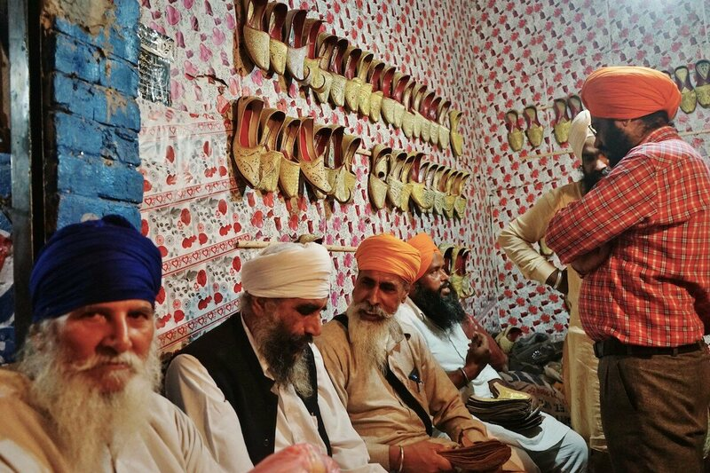 A group of Sikh men in the bazaar of Nankana Sahib, Pakistan during the birth celebrations of Guru Nankana in his hometown.