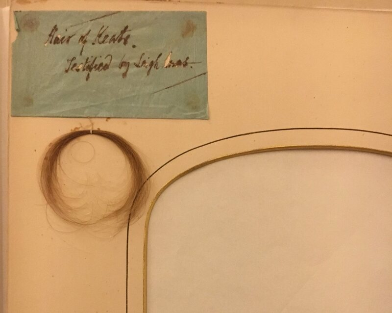 John Keats's hair, with a note from Leigh Hunt attesting to its provenance. The empty frame probably originally contained a portrait of the poet.