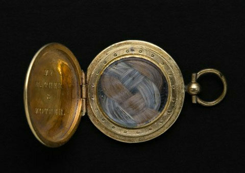 Emily Norcross Dickinson's locket, containing her parents' hair.