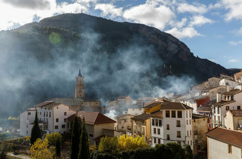 Smoke billows from the streets of Arnedillo.