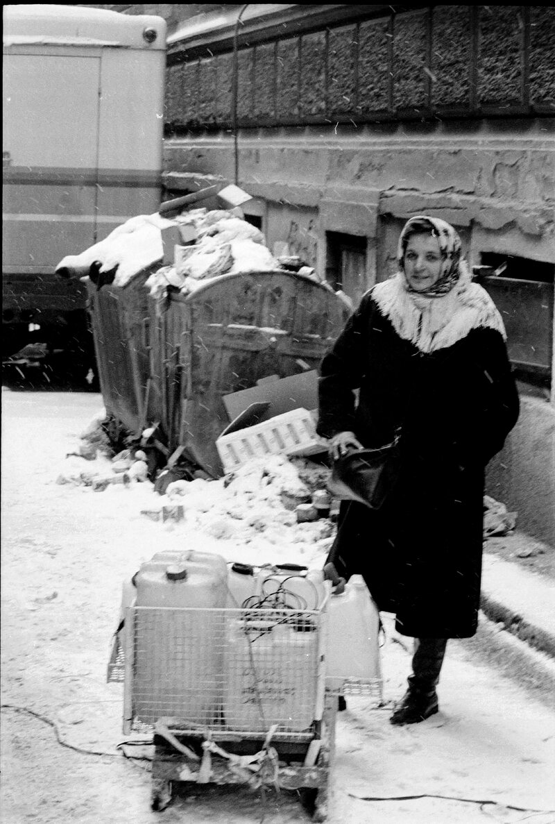 A woman, pictured in 1993, filling up jugs of water in Sarajevo.