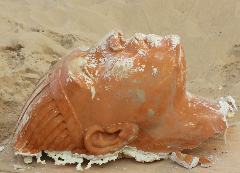 The head of the plaster sphinx, following days of excavation.