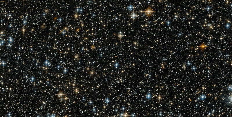 A photograph of stars and galaxies taken by the Hubble Space Telescope.