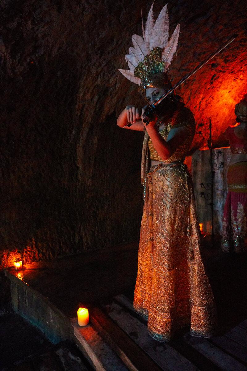 Violinist Adriana Molello plays in one of Albion Castle's subterranean waterways.