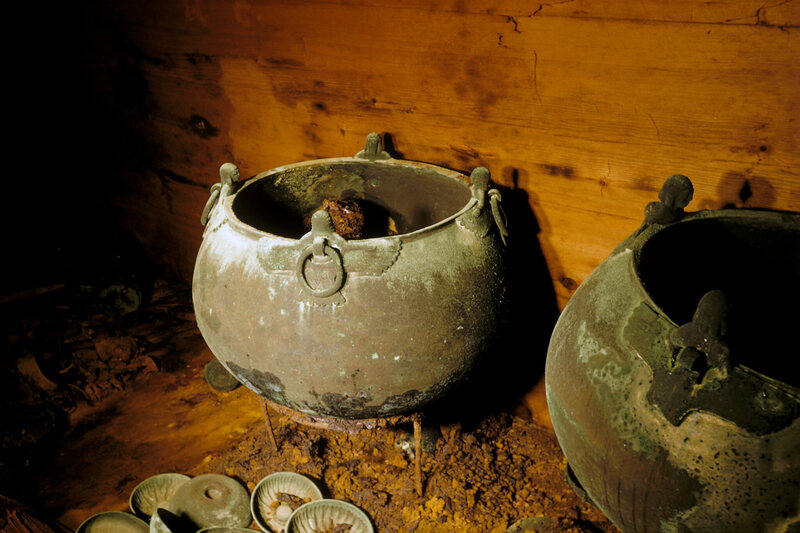 The tomb was filled with cauldrons and drinking bowls.