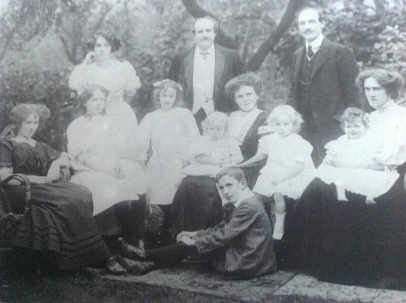 Elmes, as a baby, pictured on the far right and perched on her mother's knee.