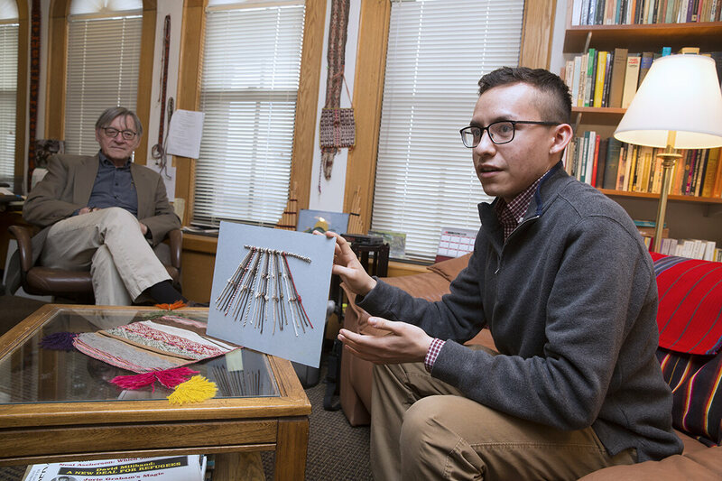 Manny Medrano (right), with guidance from Professor Gary Urton, has decoded the meaning behind khipus, an Inca bookkeeping method of knotted rope.
