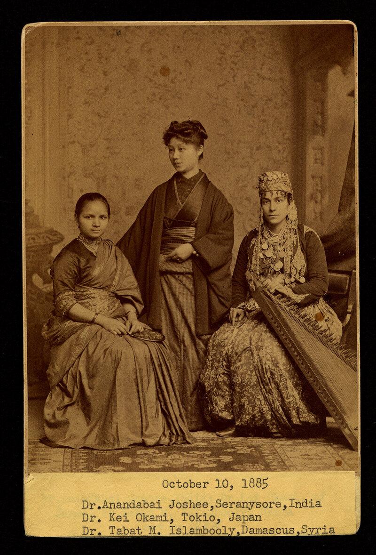 International students Anandabai Joshee, Kei Okami, and Tabat Islambooly, photographed at the Dean's Reception on October 10, 1885.