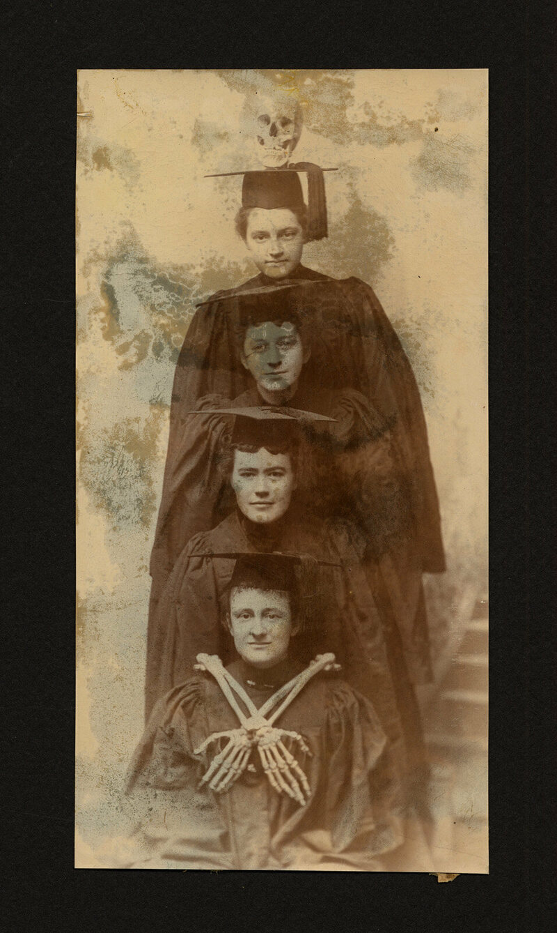 Four graduates, along with a skull and some bones, from the scrapbook of Laura Heath Hills, class of 1896.
