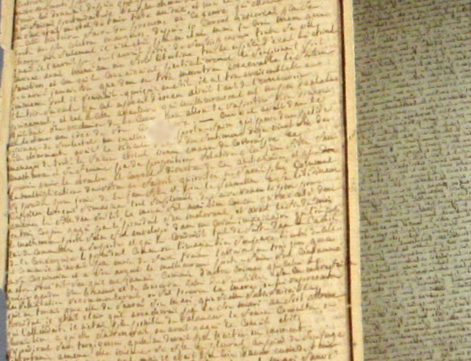 Detail from the scroll shows line after line of tiny handwriting, with few to no corrections.