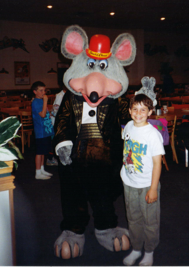 Charles Entertainment Cheese poses with a fan in 1992.