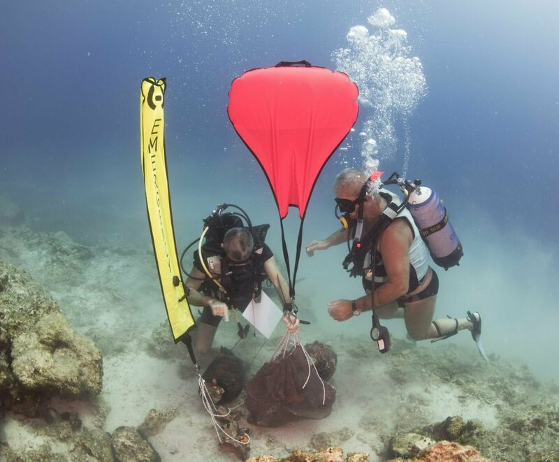 Marine archaeologists lifting ceramic finds with an airbag.