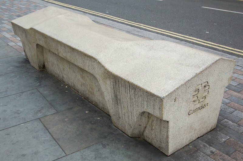 """A so-called """"Camden bench,"""" designed to make it hard for people to sleep or skateboard on."""