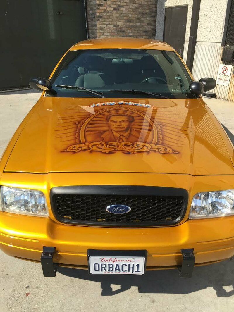 A front view of the Jerry Orbach memorial car, license plate on full display. (Airbrush by Oscar's Graphics, body paint by Diamond Coat.)
