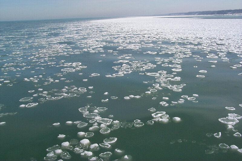 Pancake ice and ball ice float through Lake Michigan in 2000.